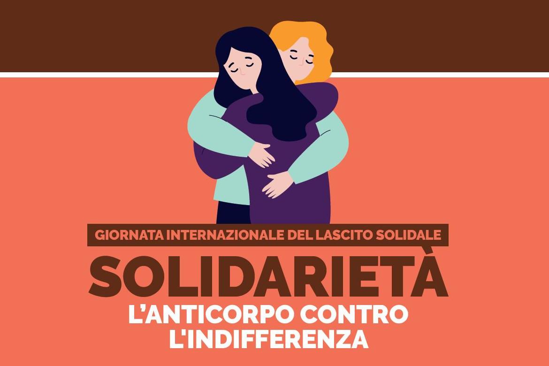 """Immagine con grafica. Su sfondo rosso e marrone, sono raffigurate due donne che si abbracciano, mentre sotto c'è la scritta """"Giornata Internazionale del Lascito Solidale - Solidarietà - L'anticorpo contro l'indifferenza"""""""